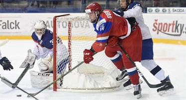 POPRAD, SLOVAKIA - APRIL 20: Russia's Andrei Svechnikov #14 stickhandler the puck while being checked by Slovakia's Daniel Demo #18 during quarterfinal round action at the 2017 IIHF Ice Hockey U18 World Championship. (Photo by Andrea Cardin/HHOF-IIHF Images)
